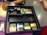 The game may have kicked our ass, but it's a lot of fun, the art is beautiful, and check out this well designed box organizer (seriously, I am a sucker for a game with a good box organizer).