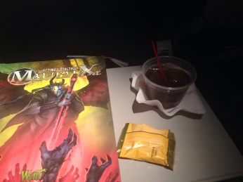 Ending the trip like I began it: with a Jack & Coke on the plane (although this time I have some new reading material).