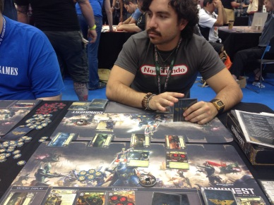 "Conquest: one of Fantasy Flight Games' ""living card games."" I was about as amused with this game as my friend looks."