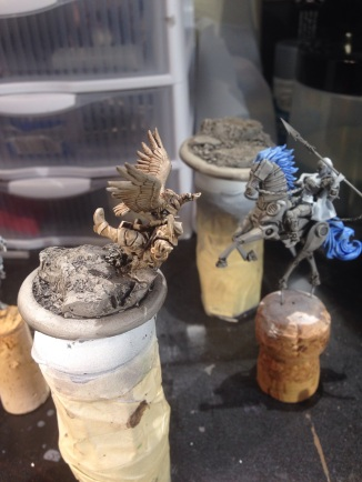 A custom Malifaux Raptor I am working on; since the model isn't out in plastic I converted a Guild Austringer because it's fun (also I really hate the Guild). You can also see my Mechanical Rider in the background.