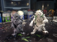 A side by side comparison of the new plastic Slate Ridge Mauler and the older metal one.
