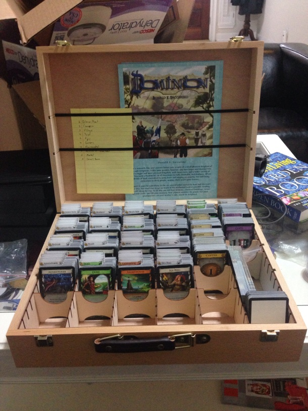 The contents of all of those boxes fit into this one. I can finally take Dominion with me to game night!!!