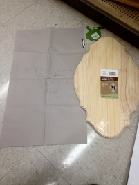 Checking how the full sized sketch of the rapier hilt looks next to the pre-made plaque for proper sizing.
