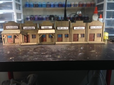 "My old west buildings for Malifaux are coming along great! I decided to name my Badlands outpost town ""Twisted Branch"""