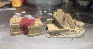 Great resin terrain pieces from Plast Craft Games. The crates are nearly finished and the coffin pile just needs detail work.